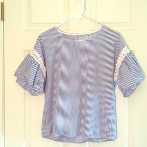Blue and white striped top with flared sleeves